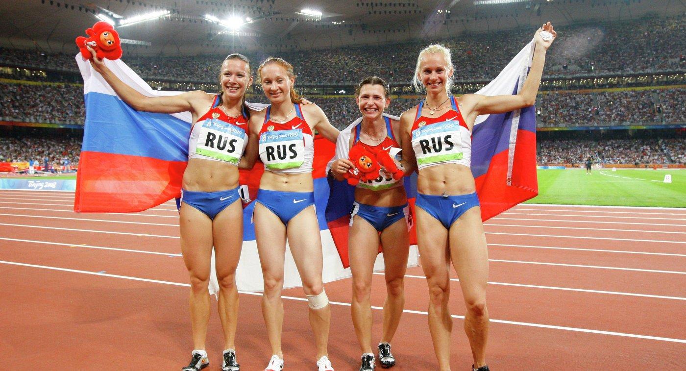 Российские бегуньи лишены золота ОИ-2008 в эстафете из-за допинг-пробы Юлии Чермошанской